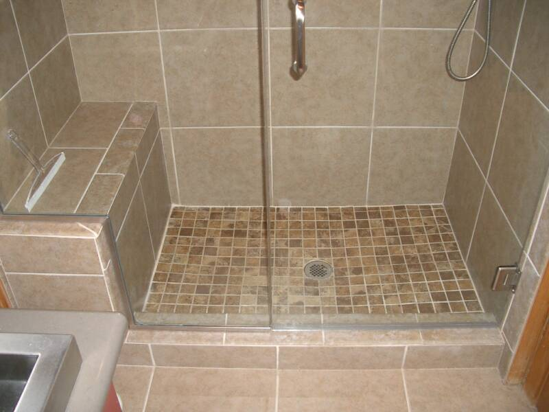 2 x 2 custom poured shower pan with contrasting 12 x 12 tile on walls and